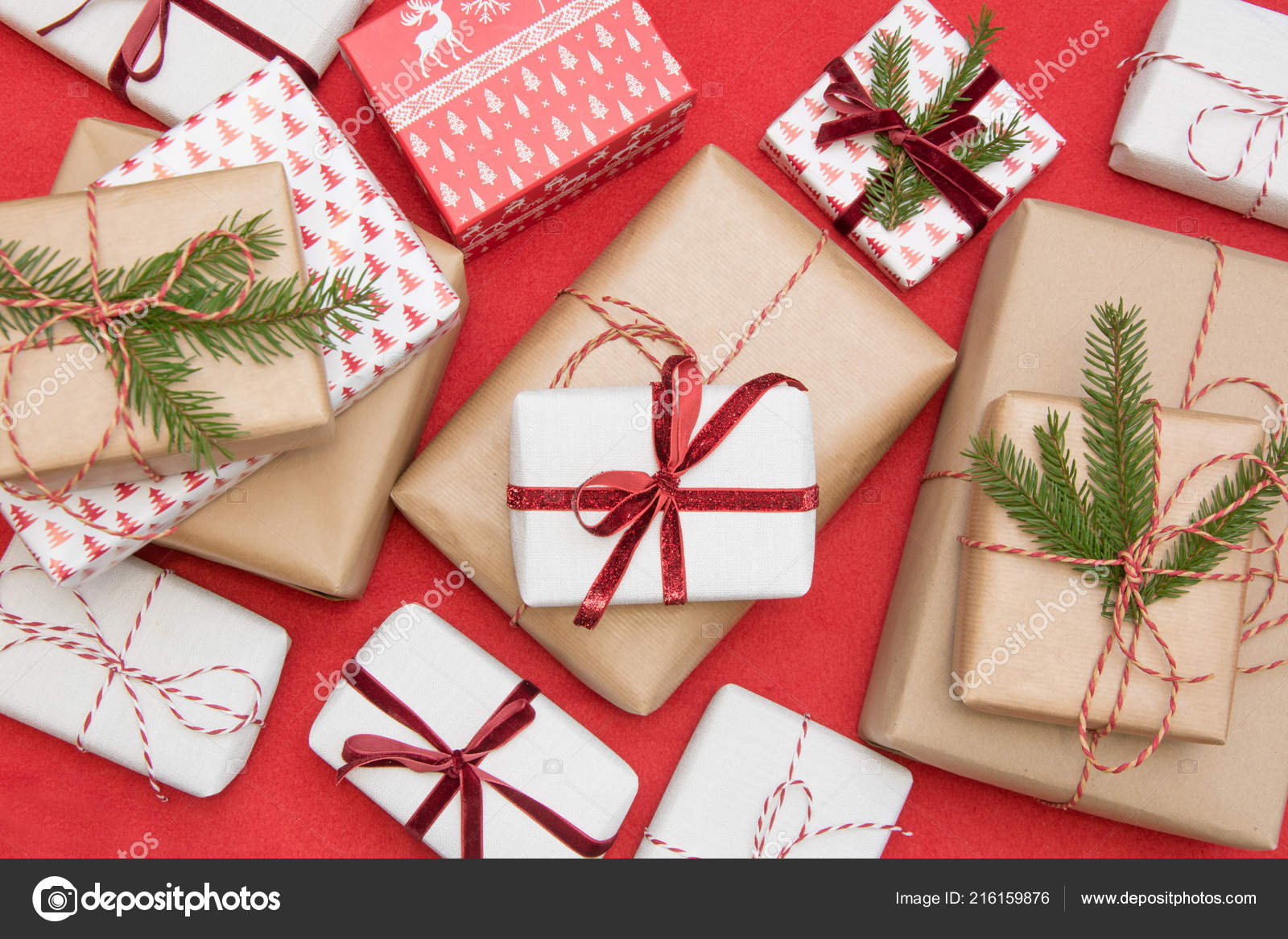 Christmas gift box wrapped in ornament paper and decorative red rope