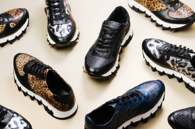 Pattern made of stylish various sneakers. Fashion design. Flat lay, top view