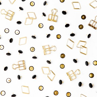 Various paper clips and pushpins on white background.