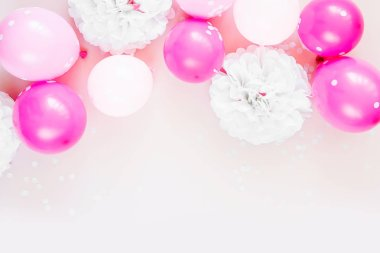 pastel pink balloons on white background