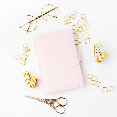 Pink planner with Business Stationery concept. Flat lay, top view
