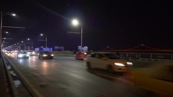 Footage of Wuhan city with busy traffic at night ,China