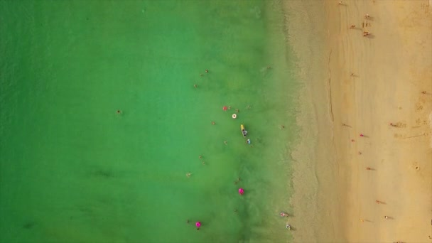 PHUKET, THAILAND - JANUARY 15 2018: Tourists on resort beach of phuket island. 4k footage
