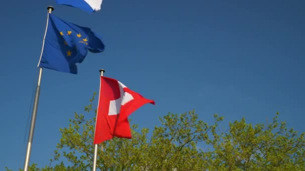sunny day zurich city national and european flag slow motion panorama 4k switzerland