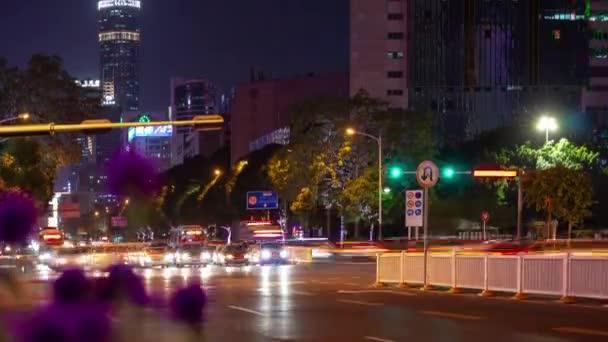 Night time illumination shenzhen downtown traffic street crossroad top view 4k timelapse china