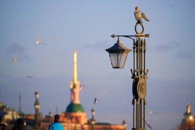 sculpture is a lantern on Ioanovsky Bridge on a hare island whe