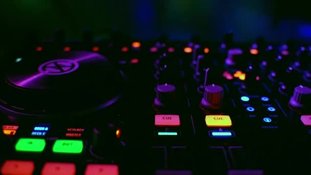 music professional DJ mixer in a nightclub at a party