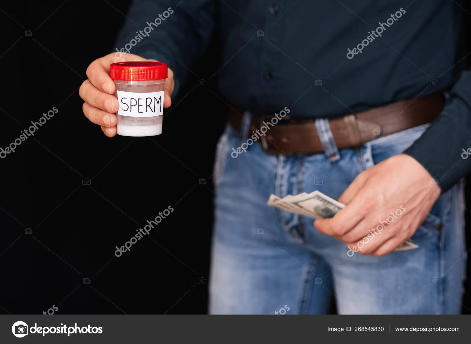 Sperm Bank and earn money to bills in hands — Stock Photo .