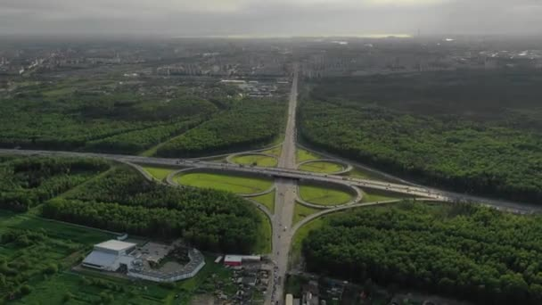 Aerial drone hyper lapse or time lapse video of popular highway of Attiki Odos multilevel junction road, passing through National motorway in traffic jam, Attica, Greece