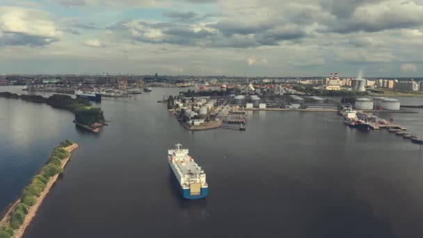 AERIAL. Container ship in export and import business and logistics. Shipping cargo to harbor by crane. Water transport International. Aerial view