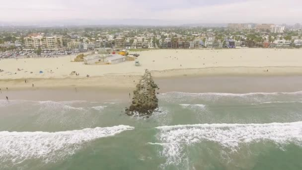 Aerial shot coming from the ocean into Venice Beach in California