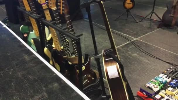 Electric acoustic guitars and pedals on stage