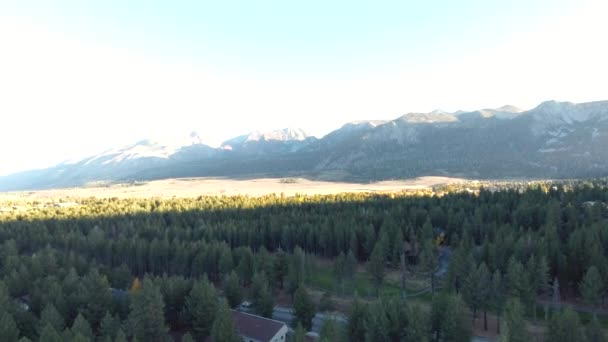 Daytime aerial shot of Mammoth Lakes, California showing mountains and trees