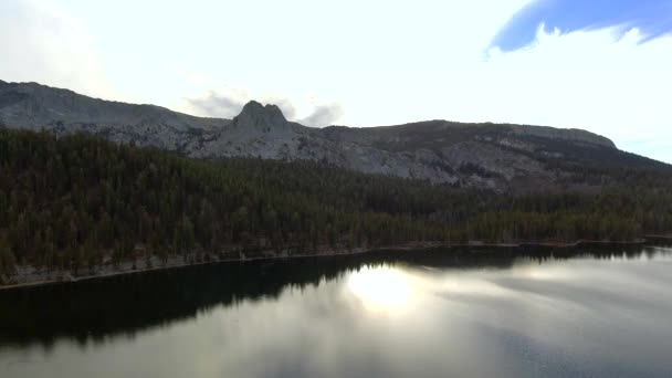 Daytime aerial shot over lakes and mountain in Lake Mary in Mammoth Lakes, California