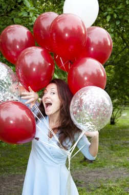 happiness. happy woman with party birthday baloons outdoor in summer