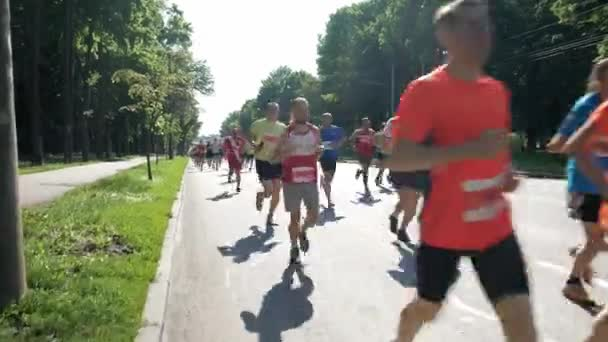 Vinnytsia Ukraine - May 26, 2019: Crowd of people who is running on marathon event. Athletes participate in the big race for 21 kilometers.