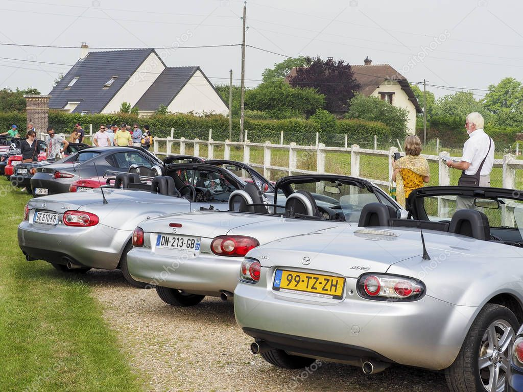 Documentary editorial image. ELBEUF, FRANCE, June 10, 2018. Different generation of Mazda MX5 joined for a meeting and parade for the week end. Differents models, differents colors but all MX5