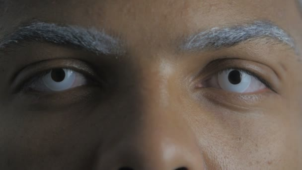 Close Up of Eyes of Afro-American Man with white eye lenses