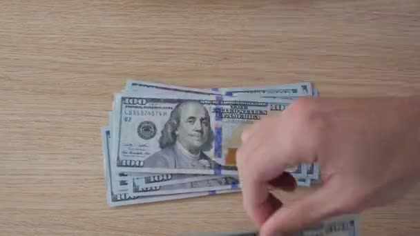 Timelapse of Man counts money. Dollars in hand, money in hand, counts the money