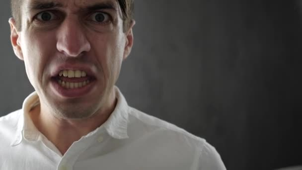 Close-up of angry businessman screaming and threatened with violence