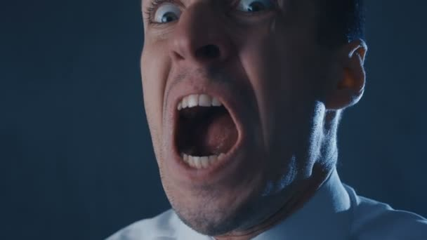 Close-up of angry businessman screaming, showing fear, rage and frustration.