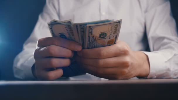 Close-up of businessman hand counting money 100 dollar bills