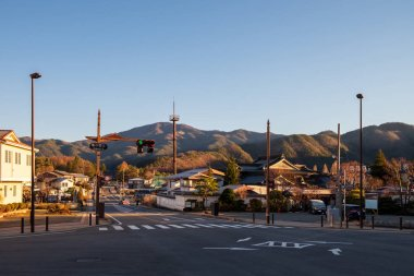 The road and the village in Japan with the back view is a mountain