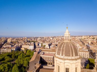 Aerial view of the Cathedral of Sant'Agata in the middle of Catania with Etna volcano on the background