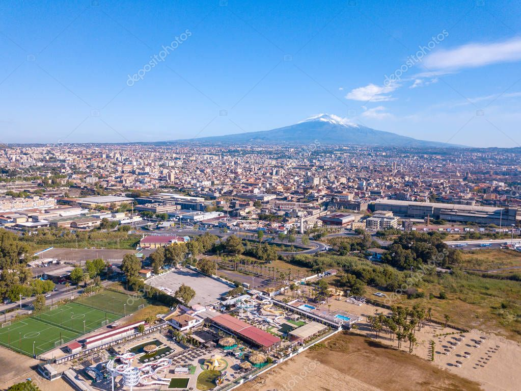 Amazing aerial Catania old town view from above with mighty Etna volcano on the background.