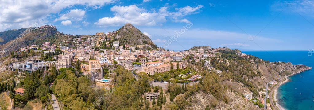 Aerial view of the Duomo in most popular Sicilian resort Taormina. Townscape of Taormina with cathedral, square and the hill with other buildings.