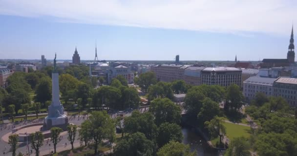 May 20, 2018. Riga, Latvia. Aerial view of the Lattelecom marathon 2018 with people running by the statue of liberty - Milda.