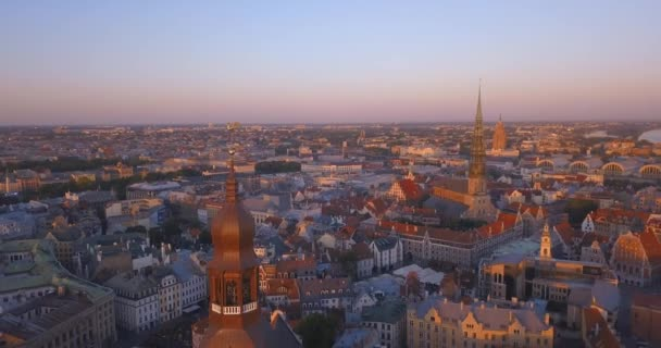 Riga, Latvia. May 20, 2018. Amazing aerial view of the sunset over Old town of Riga, Vecriga in Latvia. River Daugava, with Domes cathedral and golden cock in the foreground.