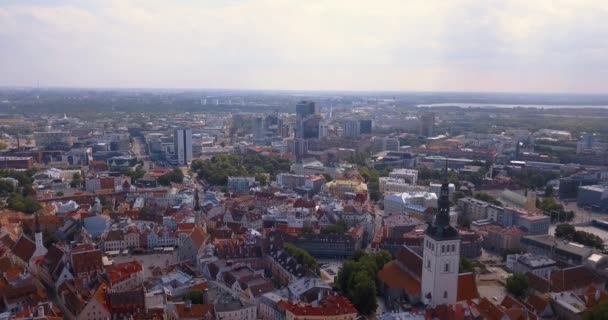 Amazing aerial Tallinn view over the old town near the main square, cathedral and narrow streets surrounded by orange roofs.