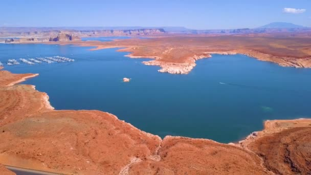 Aerial view of the Lake Powell from above in Nevada. Beautiful view of the lake near the dam with jet ski in the water.