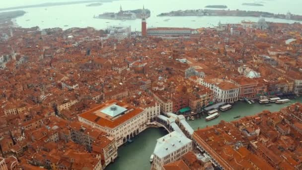 Aerial panoramic view of famous Canal Grande and famous Rialto Bridge at sunset in Venice, Italy.