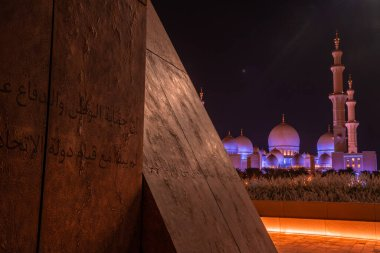 ABU DHABI, UAE - MAY, 2020: Panoramic image of Wahat Al Karama (Oasis of Dignity), permanent memorial for its martyrs, and Shaikh Zayed Grand Mosque.