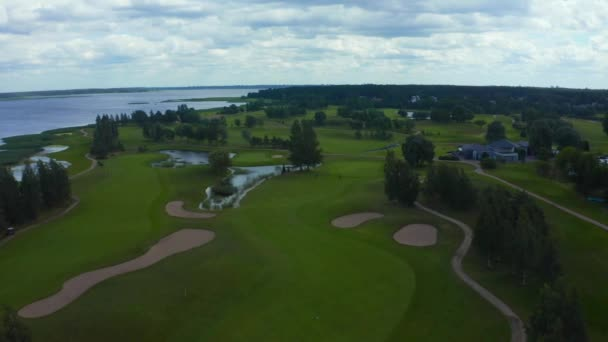 Aerial view in golf course by the lake with blue sky background