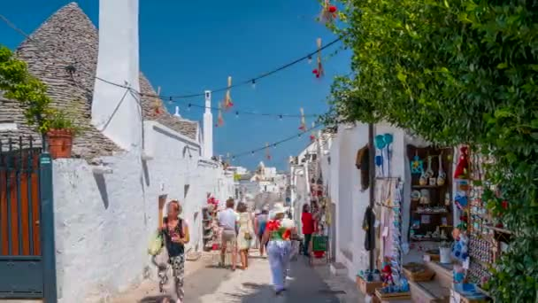 Alberobello, Italy. July 10, 2020. Timelapse view of the traditional trulli houses in Arbelobello, province Bari, region Puglia, Italy. Beautiful old town of Arbelobello with small white houses.