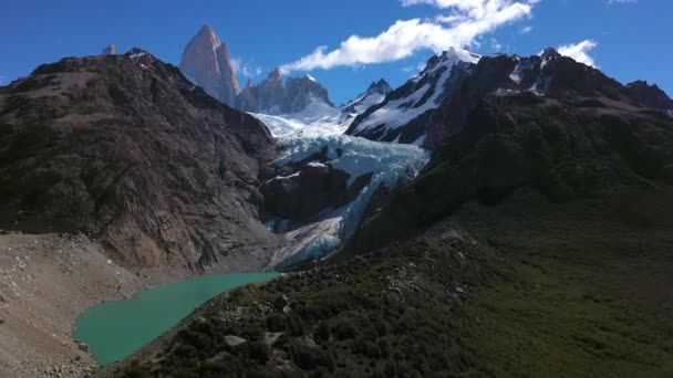 Aerial drone panoramic view of Mount Fitz Roy with the glacier and rocks in the foreground. Patagonia, Argentina.