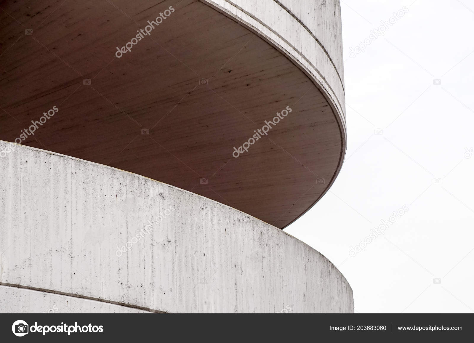 Detail at circular ramp to a parking garage  It is tan and
