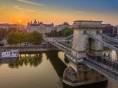 Budapest, Hungary - Aerial view of the Szechenyi Chain Bridge at sunrise with St. Stephens Basilica at background