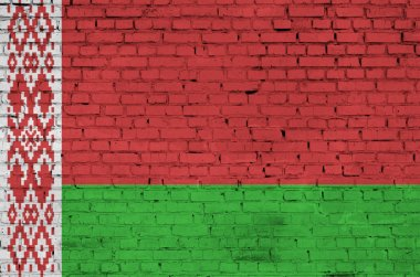 Belarus flag is painted onto an old brick wall