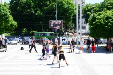 KHARKIV, UKRAINE - 27 MAY, 2018: Women's teams play streetball in the open air during the annual festival of street cultures.