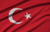 Fotografie Turkey flag  is depicted on a sports cloth fabric with many folds. Sport team waving banner