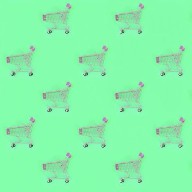 Shopping addiction, shopping lover or shopaholic concept. Many small empty shopping carts perform a pattern on a pastel colored paper background. Flat lay composition, top view