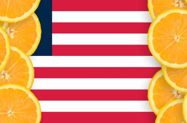 Liberia flag  in vertical frame of orange citrus fruit slices. Concept of growing as well as import and export of citrus fruits