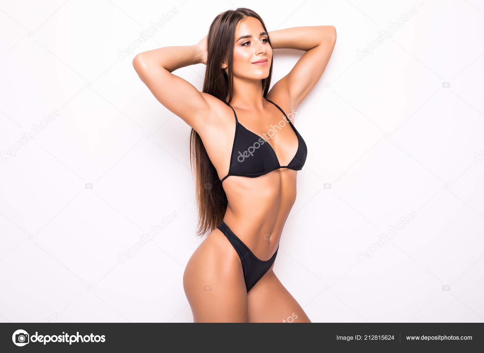 c457ebc75ee10 Slim body of young woman in black bikini. Girl with healthy sporty figure  isolated on white background — Photo by dan.grytsku.gmail.com| ...