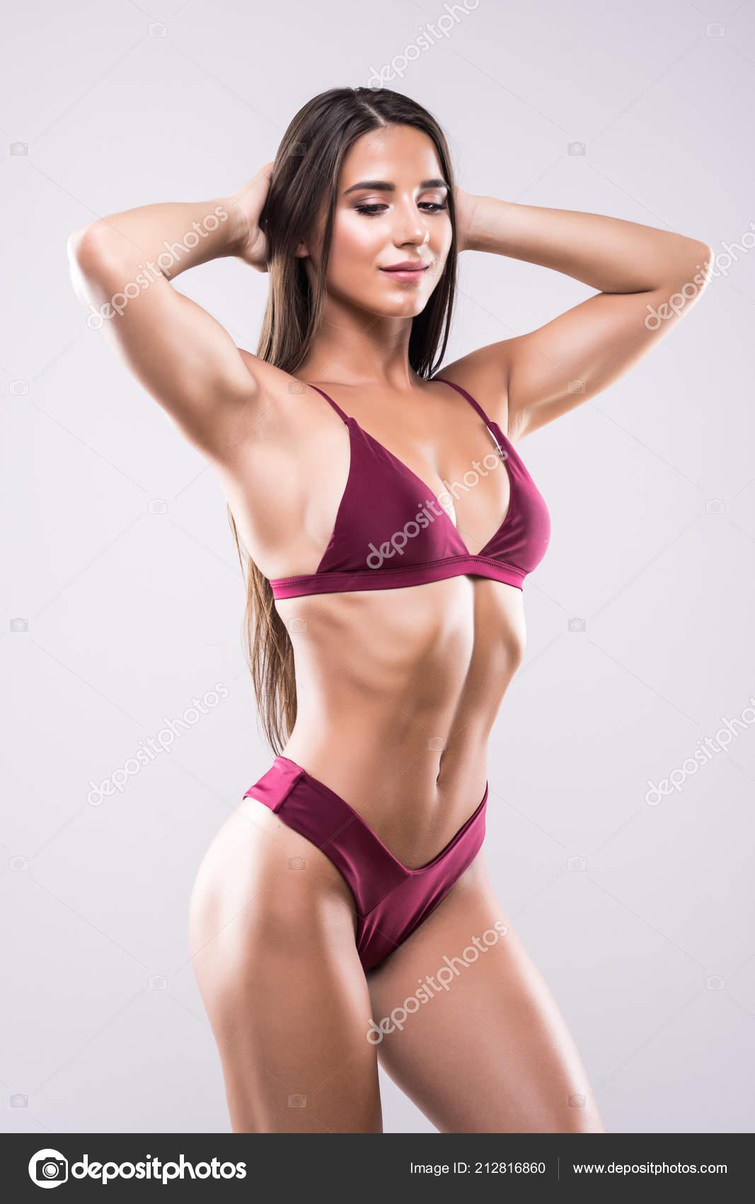 bdf16c46911ad Slim body of woman in bikini. Girl with healthy sporty figure isolated on  white background — Photo by dan.grytsku.gmail.com| ...