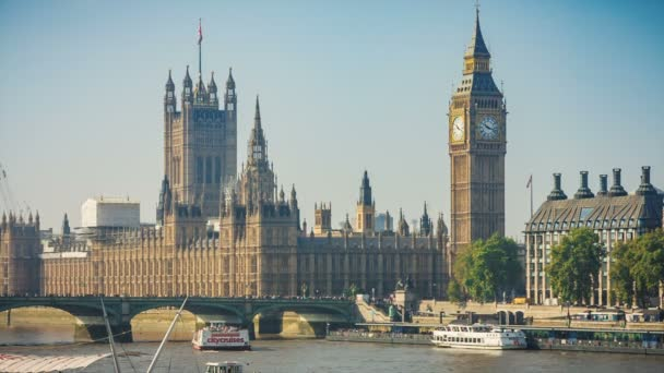 Houses Parliament, Tower Clock, Big Ben and bridge traffic car over Thames River, London, UK in sunny day