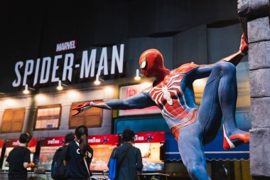 Bangkok, Thailand - Aug 18, 2018: New Spider-Man PS4 game event in PlayStation Experience SEA (South East Asia) 2018. Spiderman model showing at demo booth with gamer playing trial version of the game